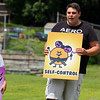 """Brandon Robbins an instructor with the Famly Martial Arts Center wotks with the kids at Michael """"Bale"""" DiConza Memorial Park during Parks Day in Fitchburg. SENTINEL & ENTERPRISE/JOHN LOVE"""