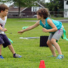 """Harry Leonard, 7, and his sister Sadie Leonard, 8, run through a drill  with the Famly Martial Arts Center at Michael """"Bale"""" DiConza Memorial Park during Parks Day in Fitchburg. They were trying to take each others flags hanging from their waist. SENTINEL & ENTERPRISE/JOHN LOVE"""