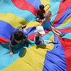 """Kids and councilors have fun playing with a Parachute at Michael """"Bale"""" DiConza Memorial Park during Parks Day in Fitchburg. SENTINEL & ENTERPRISE/JOHN LOVE"""