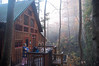Mary S. taking in the early morning  mist at the cabin