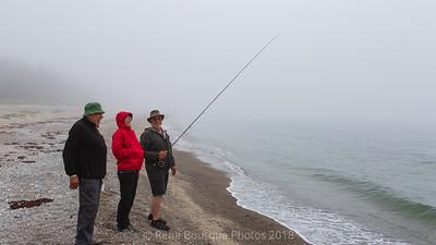 Brouillard et pêcheurs dans la baie de Patate