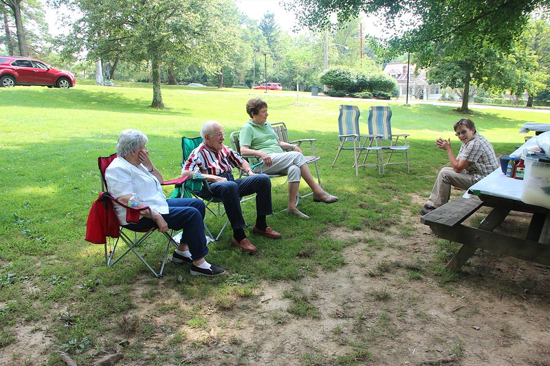 Early picnic arrivals relaxing .
