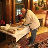 AL P. CUTTING UP A PIE AFTER DEPOSITING IT ON THE DESSERT TABLE