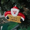 A SANTA CARVED ORNAMENT