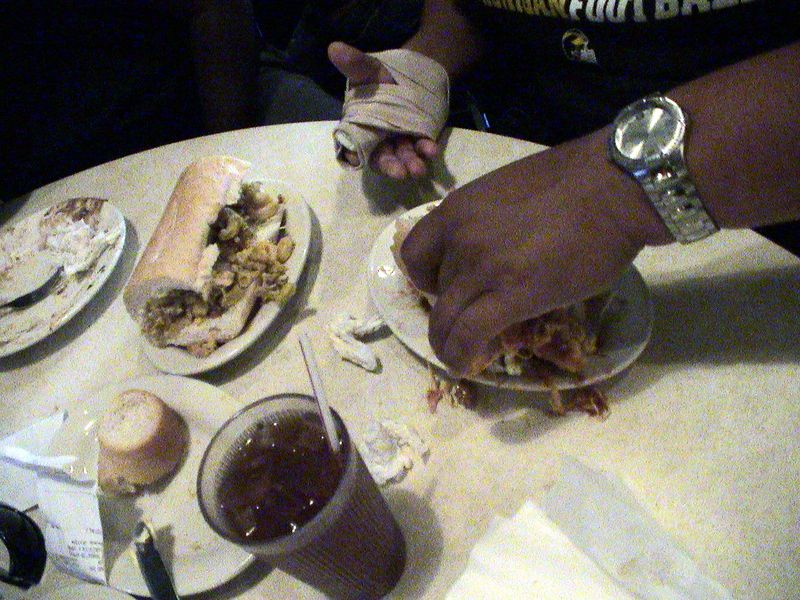 Carlos trying to eat with one hand.  Supposedly he broke his finger swatting a fly.