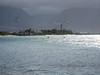 Kym waterskiing behind a kiter
