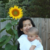 On Actual 100th Day, June 23, 2011. A big Sunflower bloomed in out front yard to celebrate Harrison being 100 days old.