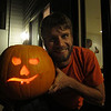 My large-headed, small-faced pumpkin with it's small-headed, large-faced carver.