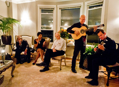 Bohemian Club afterglow party at Margaret Mitchell's - Freddy Clarke on guitar; Derek Mueller, seated with white shirt; Jerry Davis, on left with smartphone camera