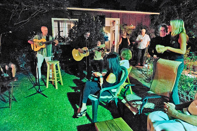 Freddy Clarke on guitar, left; Eva Strauss-Rosen, 2nd on right  - Freddy Clarke birthday party