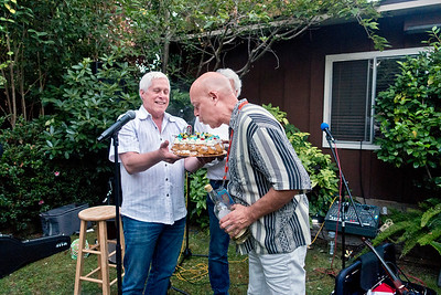 Freddy Clarke, right, receiving birthday cake and blowing out candles  - Freddy Clarke birthday party