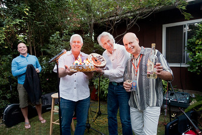 Michael Leach, left; Freddy Clarke, right, receiving birthday cake  - Freddy Clarke birthday party