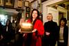 Birthday party at Robert Flynn Johnson - Farah Spott bringing Robert Flynn Johnson's birthday cake