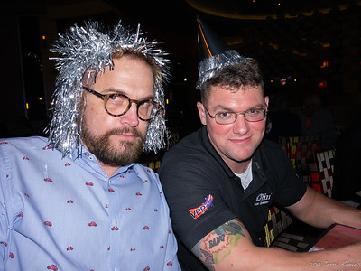 Wesley (wears a very stylist tinsel wig) and Chris (wears the latest birthday cone hat) - having a wild time in Sugarland