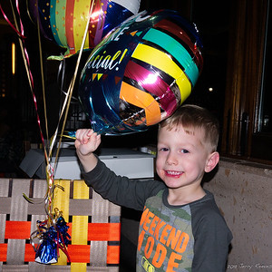 Troy playing with the birthday balloons.