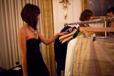 Anchyi Wei-Clements browses the clothing racks at the Alliance Française Beaujolais Nouveau Party at the Washington Club on November 18th, 2011.