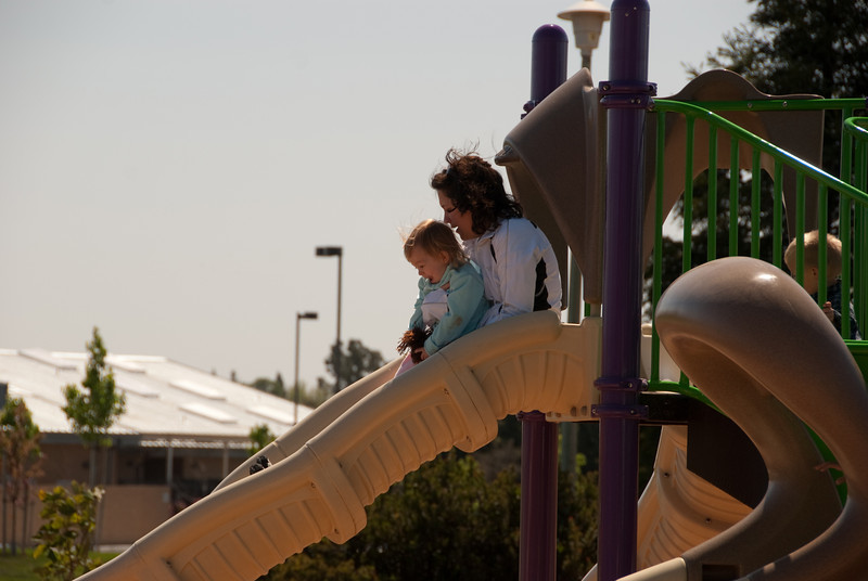 Beth and Ellie take a ride down the slide
