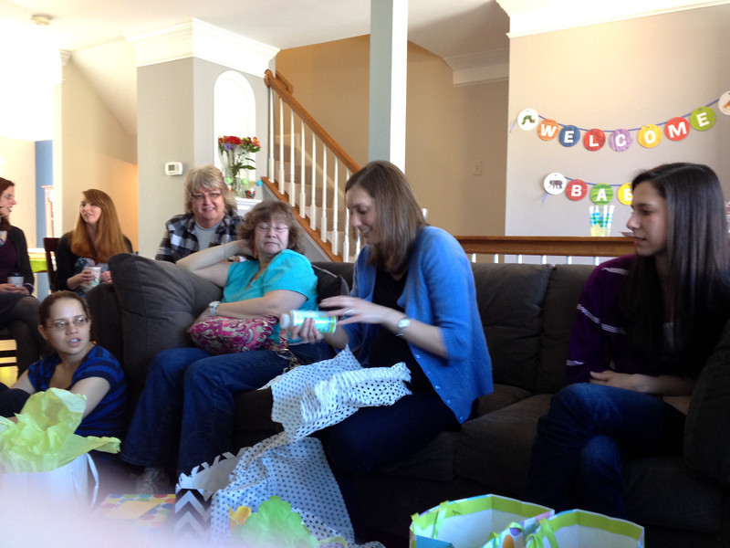 """Cindy hosted a beautiful baby shower with a theme inspired by the children's book, """"The Hungry, Hungry Caterpillar.""""  A gathering of about 15 women consisting of family, co-workers, college friends  and neighbors all helped to celebrate the occasion with gifts and their favorite children's books."""