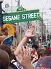 Sesame Street sign pole dancing.