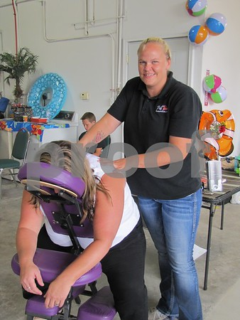 "Jenn Pirie, licensed massage therapist, gives a massage to Michelle Reed.  Pirie operates ""Past Tense"" in Fort Dodge."