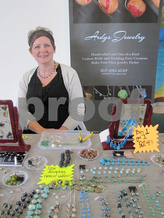 Ardys Cook with her beautiful handmade jewelry at the 'Ladies Night Out' shopping event held at NorthLand Travel.