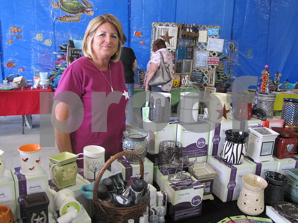 Pam Smith, independent consultant of Scentsy fragrances, in her booth at 'Ladies Night Out' at NorthLand Travel.