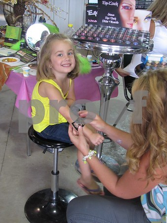 Addison Ramirez gets a temporary sparkle tattoo from Angie McColley of Uptown Elegance in Clare.