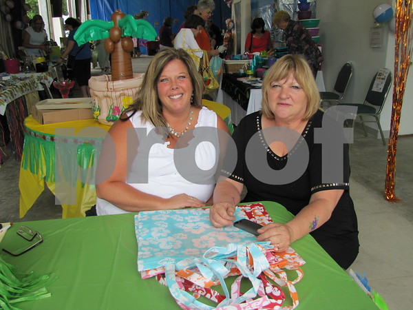 Michelle Reed of NorthLand Travel and Barb Hunt of Uptown Elegance greeted visitors to 'Ladies Night Out'.