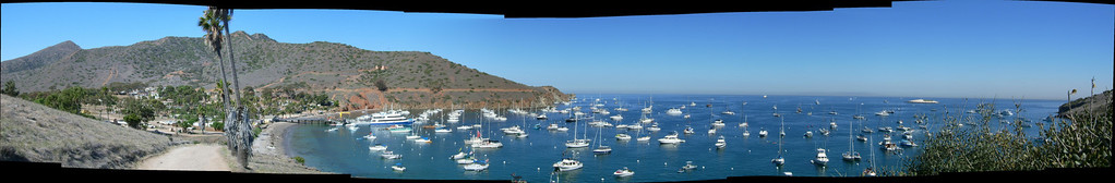 """<font size=""""Large"""" color=""""Red"""">Buccaneer Days is an annual event on Catalina Island.  For this shot I stitched together 20 individual photos of Two Harbors, showing  a single 245 degree sweep of the harbor as seen from our campsite on the bluff.</font>  <h2><font color=""""gold"""">==><a href=""""http://truebob.smugmug.com/photos/206380868-O.jpg """"  /target=blank onClick=""""javascript:urchinTracker('/outgoing/Panorama');"""">CLICK HERE</a> to enlarge and pan through the harbor detail. (You may need to click the picture in the new window to pan)</font></h2>"""