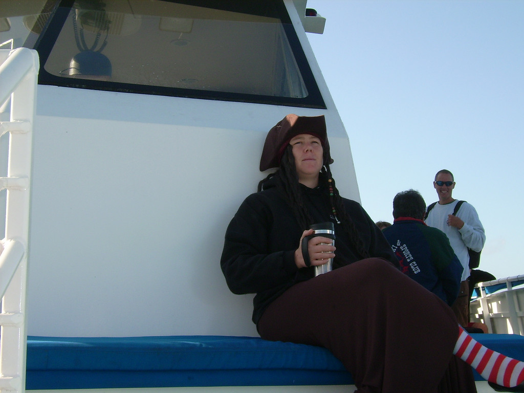 A pirate lass on the foredeck (with coffee)