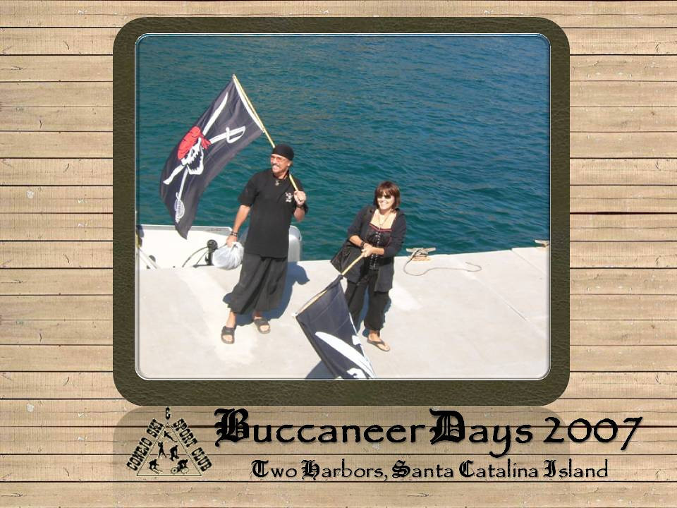 """<h3>These are our hosts, Bad Pirate Man Gary and Pirate Queen Mary,  for 38 landlubbers from <a href=""""http://conejoskiclub.org"""" /target=blank onClick=""""javascript:urchinTracker('/outgoing/SkiClub3');"""">Conejo Ski & Sports Club</a> who undertook this  3 day Buccaneer Days 2007 voyage.  We, the survivors,  be raisin' a glass and thankin ye, Arrrr, for sure, for a memorable adventure.</h3>"""