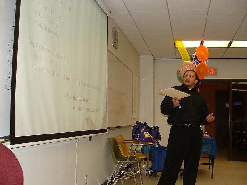 Carlos Escobar delivers his oral report.