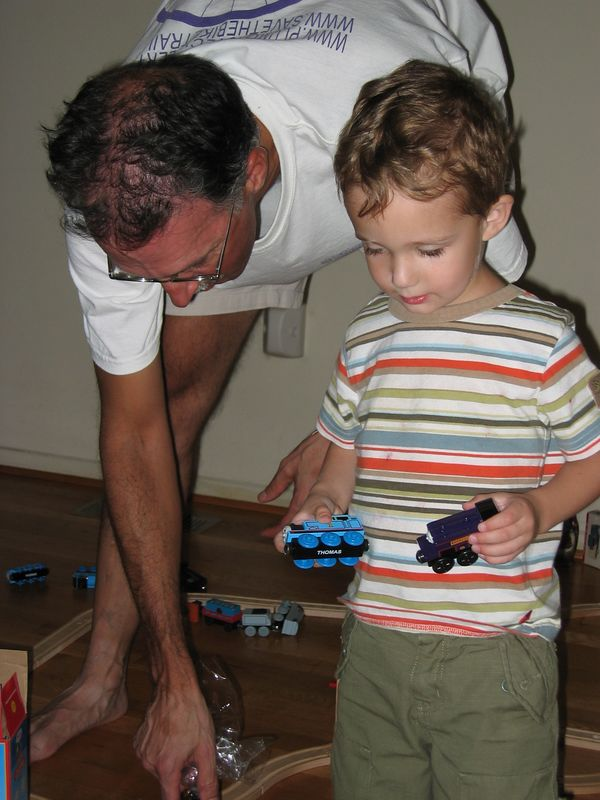 Barry and Charles play with trains.