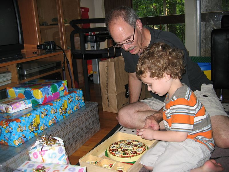 Dad and Zachary check out the pizza set.