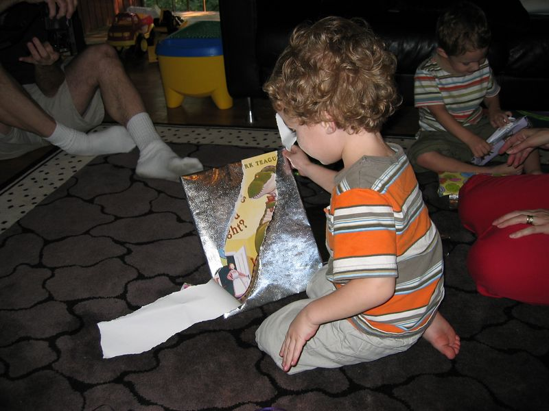 Zachary opens gifts.
