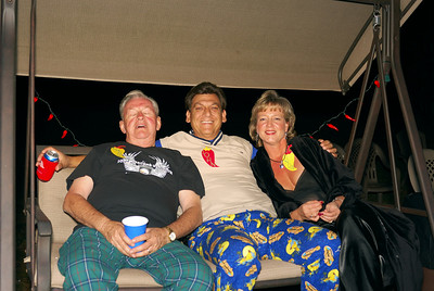 Gary is having such a good time that he is a sleep!!!!!!!!  I know, it must be the swing and the wonderful cool night air...  Linda and John are seen in their fashionable jammies, while enjoying the Yucca's and a beer...