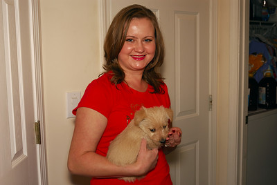 Jeff's lovely wife, Lena, enjoying one of the seven puppies - which one will she make her own?!!