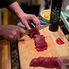 Slicing tuna crudo.