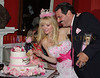 Colleen and Gary Rein admire the Barbie cake creation