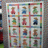Tony named the quilt Sunbonnet Sushi.  Great team work making the quilt and Paula quilted and bound it.  So cute!