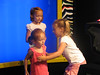 Elizabeth's friend Ryleigh was directing them in front of the camera at Chuck E. Cheese.