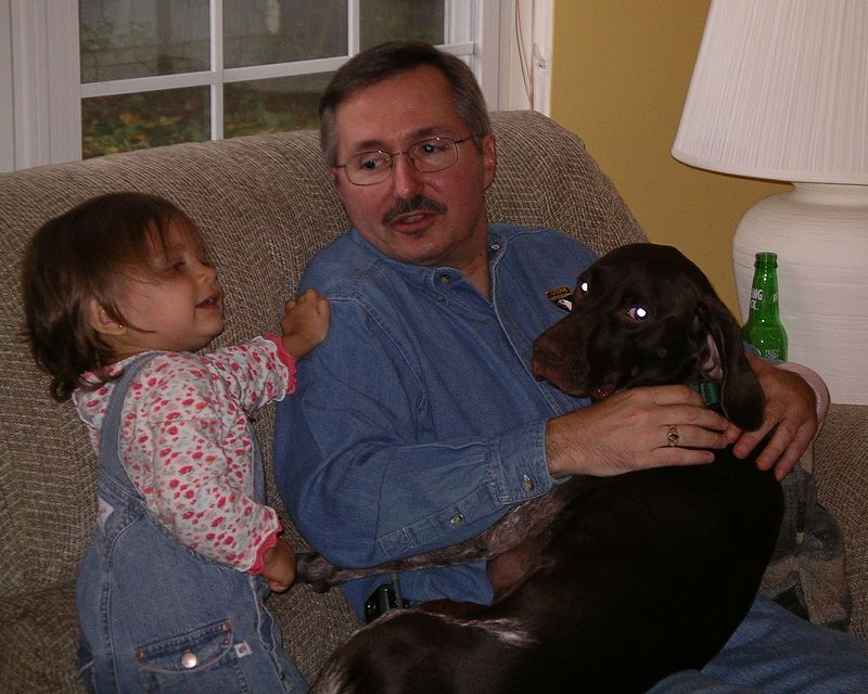 Hold on here Uncle Mike! I'm the cute one and I should be on your lap!