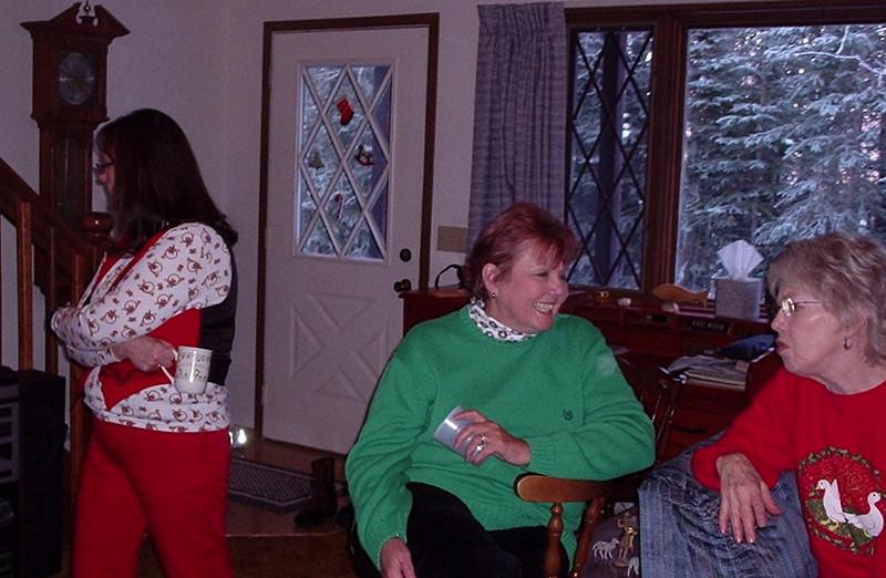 Warm conversation: Esther Richeson, Jackie Oberg, Etta Mae Near.