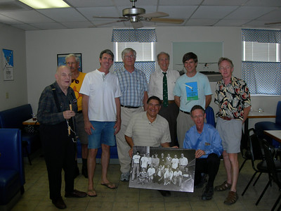 Gossamer Squadron, with Don Monroe photo of team from 30 years ago in foreground. Standing L to R: Henry Jex, Ted Ancona, Pete Plumb, Bill Watson, Joe Mastropaolo, Taras Kikeniuk Jr., Phil Esdaile. Kneeling: Sam Duran, Bryan Allen.