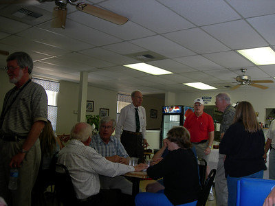 Don Monroe standing at left, Chet Kyle in white shirt w/ back to camera, Bill Watson, Joe Mastropaolo (with tie!) standing.