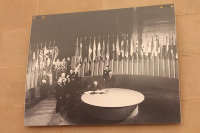 Photo from an unnamed photographer of the signing of the original United Nations Charter on June 26th, 1945.  Delegates representing over 80% of the world's population were present in this auditorium for the signing.