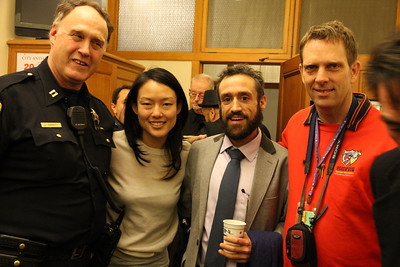 Left to right, Captain John (Joe) Garrity, Jane Kim.    Right, singing man.  I don't know his name but he sings during public comments at the Board of Supervisor hearings.