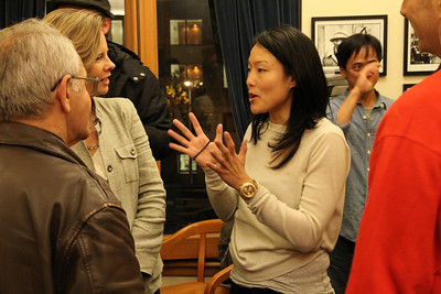 Left, Henry Karnilowicz and Kat Anderson talk with Jane Kim.
