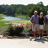 Lloyd, Janine, and Charlie at Golden Oaks heading to the 19th hole.