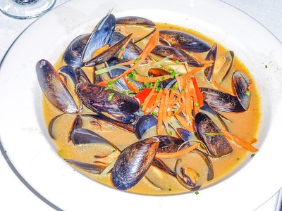 Mussels Sauteed in tomato saffron broth at Hoppe's